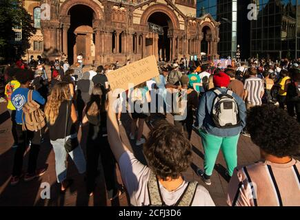 Boston, USA. 05th Sep, 2020. Rally for Black Lives, Black Voices & Jacob Blake.  Boston, MA, USA. Copley Square.  More than 500 gathered in Copley Square, in front of Trinity Church in central Boston on Sept. 5th  2020 in support of Black Lives Matter. Photo shows a Caucasian student holding a sign calling for 'Justice for Jacob Blake.'  Blake, a 29-year-old Black Man who was shot seven times in the back in Kenosha Wisconsin on August 23rd, 2020.  Credit: Chuck Nacke / Alamy Live News - Stock Photo