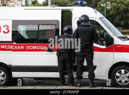 Minsk, Belarus. 6th Sep, 2020. Law enforcement officers stand by an ambulance vehicle after detaining a participant in the March of Unity event held by Belarusian opposition supporters in Victors Avenue. The announcement of the results of the 2020 Belarusian presidential election has sparked mass protests in Minsk and major cities across Belarus. Credit: Valery Sharifulin/TASS/Alamy Live News
