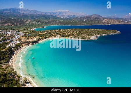 Aerial view of the beautiful sandy beach and crystal clear waters of Voulisma Beach, Crete, Greece