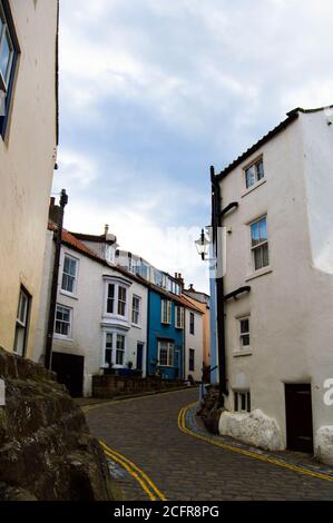 Bottom of the empty High Street in the traditional fishing village of Staithes, North York Moors National Park, North Yorkshire, England, UK