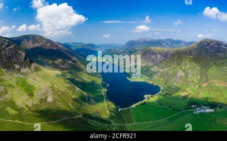 Panoramic aerial view of a beautiful lake and narrow valley (Buttermere, Lake District, England) - Stock Photo