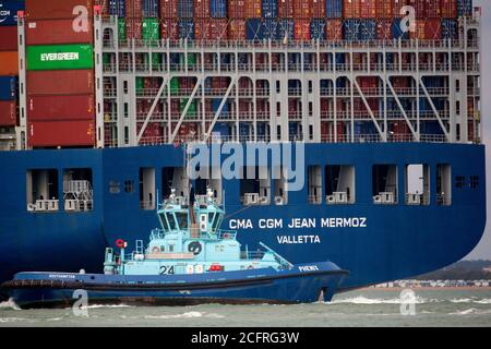 CMA CGM Jean Mermoz,Tug,Phenix,towing,The Solent,Southampton,Container Port, container,box,close,up,Cowes,Isle of Wight,England,UK,