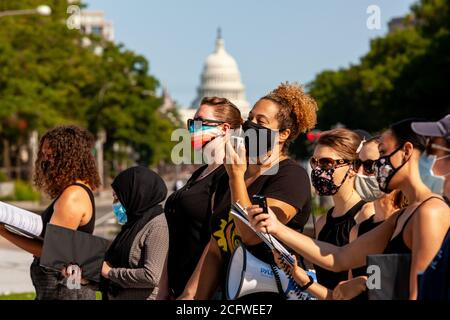 Washington, DC, USA, September 7, 2020. Pictured: Members of Songrise and the Justice Choir of DC sing during Let Freedom Sing, with the United States Capitol in the background. Let Freedom Sing was a community-building protest and voter registration event by the Freedom Day Foundation and Head Count. Credit: Allison C Bailey/Alamy Credit: Allison Bailey/Alamy Live News - Stock Photo