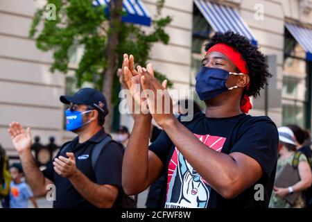 Washington, DC, USA, September 7, 2020. Pictured: Protesters clap and keep the beat as they sing during the Let Freedom Sing March en route to Freedom Plaza. Let Freedom Sing was a community-building protest and voter registration event by the Freedom Day Foundation and Head Count. Credit: Allison C Bailey Credit: Allison Bailey/Alamy Live News