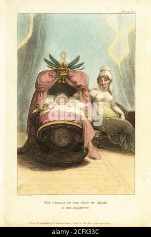 Napoleon II asleep in his cradle with his mother Marie Louise of Austria by his side, 1811. The cradle on a rocking base with gilt decoration, drapery, crown and palm leaves. Effigies of Napoleon and Marie Louise on the end. The Cradle of the King of Rome & his Majesty. Handcoloured copperplate engraving by D. Legoux from The Upholsterer's and Cabinet-Maker's Repository consisting of seventy-six designs of modern and fashionable furniture, Rudolph Ackermann, London, 1830. - Stock Photo