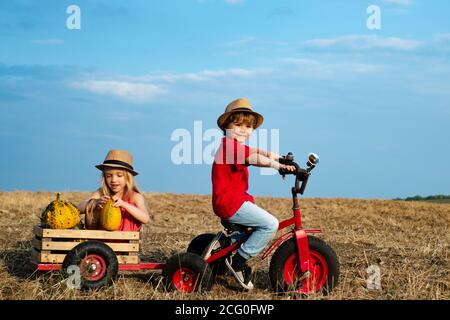 Positive little girl and boy. Beautiful fun day for cute friends in nature. Little girl and boy enjoy life and nature. Little cute kids is smiling