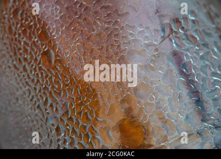 Plastic bottle texture background . Water drops due to condensation on a plastic bottle curved surface