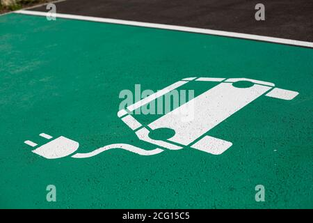 Parking symbol on the street for electric cars being charged - Stock Photo