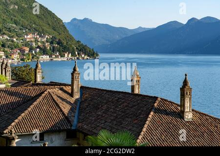 Italy. Lombardy. Lake Como. The colorful village of Varenna. Typical chimneys on the roofs of houses