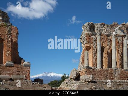 Taormina - The Greek Theatre with the Mt. Etna volcano and the City.