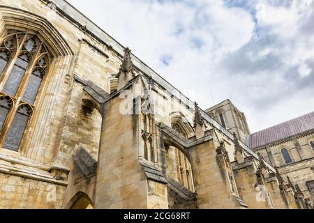 Flying buttresses and stonework on the south side of the exterior of Winchester Cathedral in Winchester, Hampshire, south England