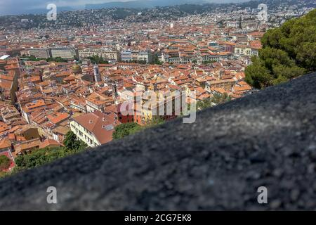Panoramic top view from the Mount Boront Park on the hill over the Nice city with atmospheric traditional houses with red tiled roofs, France. - Stock Photo