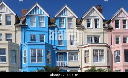 Aldeburgh, Suffolk, UK - 9 September 2020: Bright autumn day on the East Anglia coast. Pastel painted seafront houses. - Stock Photo