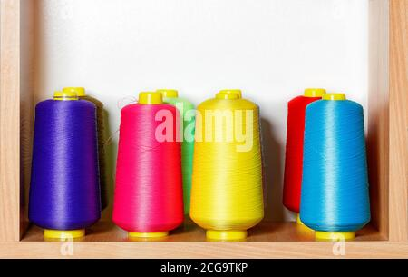 Bobbins of multicolored silk threads for embroidery and professional embroidery machines.