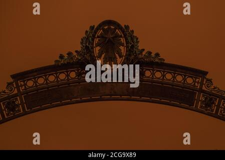 Sather gate on a hazy day where the sky turned orange from California's wild fires. - Stock Photo