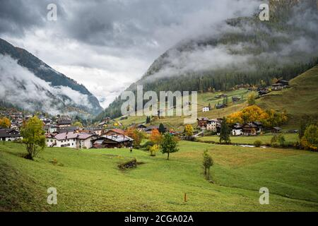 Landscape of some village in northern Italy on the slopes of the Dolomites in the valley of Val di Funes early autumn.