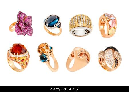 Golden diamond rings isolated on white background. Different rings with diamonds and precious color gemstones. Luxury jewelry, yellow gold. - Stock Photo