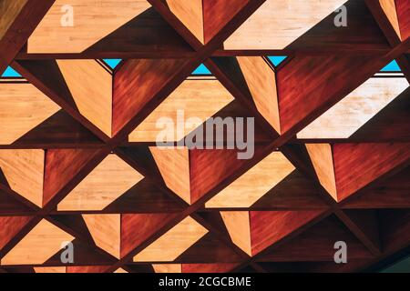 Roofing Construction. Wooden Roof Frame House Construction. Abstract Structure background. Wood texture pattern.