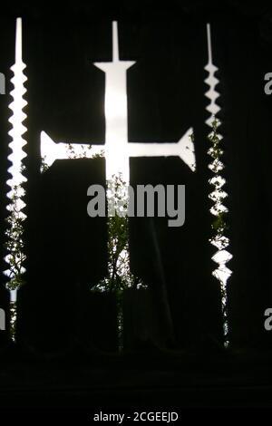 Cutout cross motif on handmade wooden gate in Romania