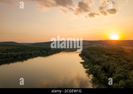 Aerial view of sunset over wide Dnister river and distant rocky hills in Bakota area, part of the National park 'Podilski Tovtry' in Ukraine Stock Photo