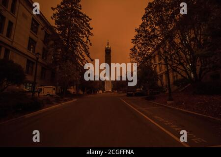 The Berkeley campus clock tower on a hazy day caused by the wild fire smoke from the fires burning across California. - Stock Photo