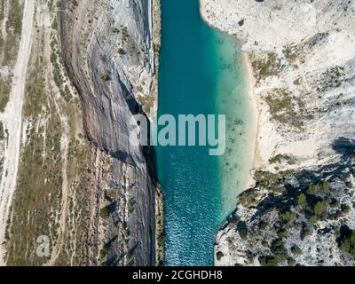 Aerial bird's eye view photo taken by drone of famous Corinth Canal with turquoise water, Peloponnese, Greece. The narrowest channel in the world and - Stock Photo
