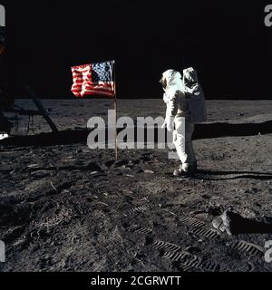 Buzz Aldrin and the U.S. Flag on the Moon 1969. Astronaut Buzz Aldrin, lunar module pilot of the first lunar landing mission, poses for a photograph beside the deployed United States flag during an Apollo 11 Extravehicular Activity (EVA) on the lunar surface. - Stock Photo