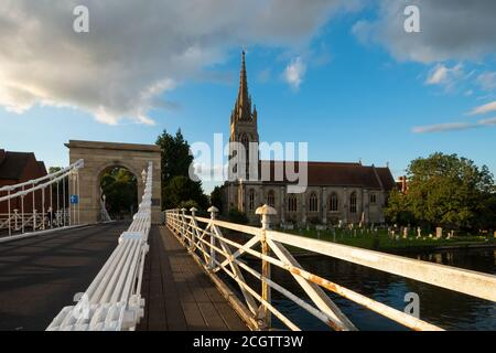 All Saints Church in Marlow, a picturesque market town in Buckinghamshire, England, UK, from the suspension bridge over the River Thames - Stock Photo