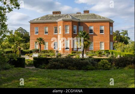 Side view of Hatchlands Park, a red-brick country house with surrounding gardens in East Clandon near Guildford, Surrey, south-east England - Stock Photo