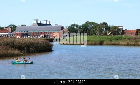 Snape, Suffolk, UK - 13 September 2020: Sunny Sunday autumn afternoon for two canoeists on River Alde at Snape Maltings. - Stock Photo