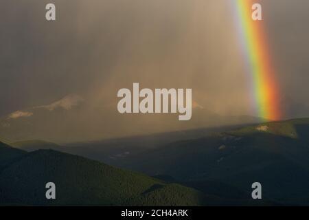 Rainbow over the Canadian Rockies, Banff National Park, Alberta Canada. - Stock Photo