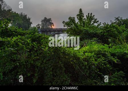 Redings Mill Bridge crossing Shoal Creek in Joplin, Missouri - Stock Photo