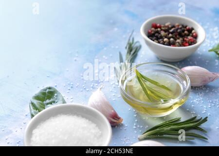Rosemary oil with spices on color background - Stock Photo