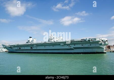 Portsmouth, UK - September 8, 2020: View of the full length of the huge Royal Navy aircraft carrier - Queen Elizabeth.  Moored in Portsmouth Harbour, - Stock Photo