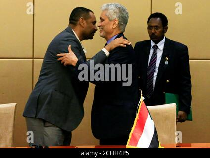 African Union mediator Mohamed El Hacen Lebatt embraces Sudan's opposition alliance coalition's leader Ahmad al-Rabiah after a constitutional declaration signing ceremony in Khartoum, Sudan August 4, 2019. REUTERS/Mohamed Nureldin Abdallah
