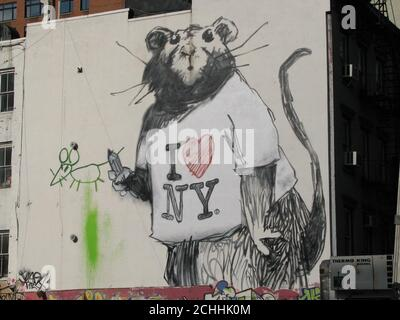 A large mural of a rat wearing an 'I Love New York' t-shirt on a wall on Wooster and Grand Street in New York City, it is though to be the elusive British street artist Banksy's latest work in New York. - Stock Photo