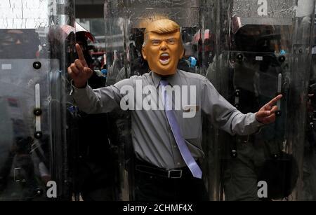 An anti-government protester wearing a mask depicting U.S. President Donald Trump demonstrates at Causeway Bay district in Hong Kong, China, September 29, 2019. REUTERS/Susana Vera - Stock Photo