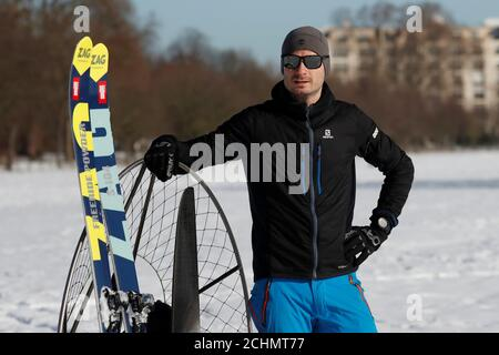French entrepreneur Antoine Taillefer poses next to his skis and a paramotor in the Bois de Boulogne public park in Paris, France February 10, 2018. REUTERS/Gonzalo Fuentes - Stock Photo