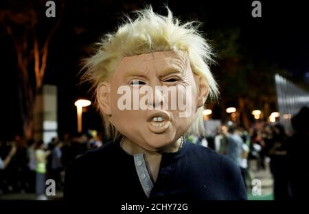 An anti-government protester wearing a mask depicting U.S. President Donald Trump attends a march during Halloween in Victoria Park, Hong Kong, China October 31, 2019.  REUTERS/Shannon Stapleton - Stock Photo
