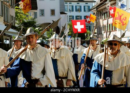 Medieval dressed participants carry halberds as they parade during the commemoration of the Battle of Sempach in the town of Sempach near Lucerne July 3, 2011. The battle was fought on July 9, 1386, a decisive victory won by the Swiss Confederation in its struggle with the Austrian Habsburgs.    REUTERS/Arnd Wiegmann (SWITZERLAND - Tags: ENTERTAINMENT) - Stock Photo