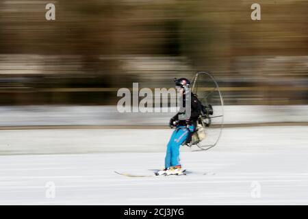 French entrepreneur Antoine Taillefer skis with a paramotor on his back in the Bois de Boulogne public park in Paris, France February 10, 2018. REUTERS/Gonzalo Fuentes - Stock Photo