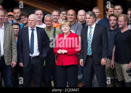 German Chancellor Angela Merkel visits facilities of yacht manufacturer HanseYachts AG in Greifswald, Germany, August 30, 2016.  REUTERS/Stefanie Loos - Stock Photo