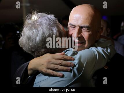 Enis Berberoglu, the first lawmaker from the main opposition Republican People's Party (CHP) to be jailed amid government purges following a failed military coup in 2016, hugs his wife Oya Berberoglu after being released from the prison in Silivri near Istanbul, Turkey, September 20, 2018. REUTERS/Huseyin Aldemir      TPX IMAGES OF THE DAY