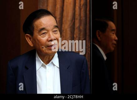 Cheng Yu-tung, founder of Hong Kong property group New World Development, attends a news conference in Hong Kong, China September 20, 2011. REUTERS/Bobby Yip/File Photo