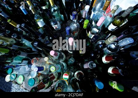 Empty glass bottles are collected for recycling in Frankfurt, Germany, May 16, 2018. Picture taken on May 16, 2018.   REUTERS/Ralph Orlowski - Stock Photo
