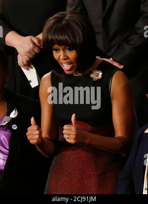 U.S. first lady Michelle Obama gives thumbs ups before President Barack Obama's State of the Union speech on Capitol Hill in Washington, February 12, 2013. REUTERS/Jim Bourg (UNITED STATES  - Tags: POLITICS) - Stock Photo