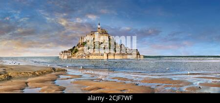 Scenic view of the tidal island  of Mont Saint Michel at high tide surrounded and its medieval abbey of Saint Michel. Normandy France.  The tides vary