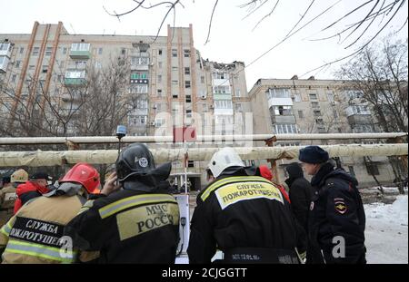 Members of emergency services gather near a damaged apartment block after an apparent gas explosion in the town of Shakhty in Rostov Region, Russia January 14, 2019. REUTERS/Sergey Pivovarov - Stock Photo