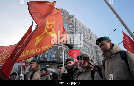 Activists and supporters of the Russian Communist Party gather before a procession to celebrate the Defender of the Fatherland Day, which was before known as Soviet Army and Navy Day, in Moscow, Russia February 23, 2019. REUTERS/Maxim Shemetov Stock Photo