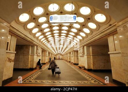 A woman walks along Elektrozavodskaya metro station in Moscow, Russia, March 26, 2017. REUTERS/Grigory Dukor    SEARCH 'MOSCOW TRAINS' FOR THIS STORY. SEARCH 'WIDER IMAGE' FOR ALL STORIES. - Stock Photo